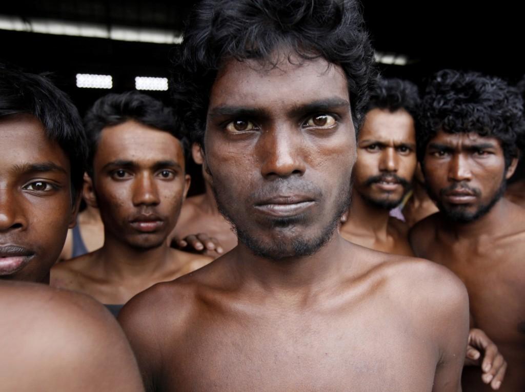 Newly-arrived migrants gather at Kuala Langsa Port in Langsa, Aceh province, Indonesia, Friday. AP Photo/Binsar Bakkara