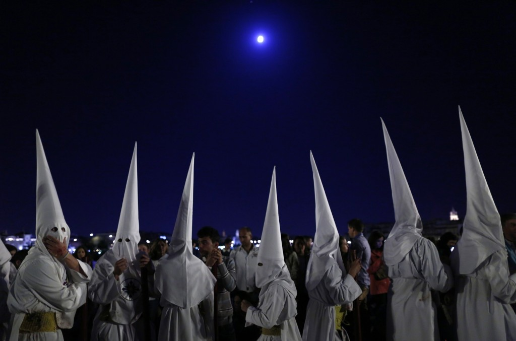 Penitents of the San Gonzalo brotherhood take part in a Holy Week procession in Seville. REUTERS/Marcelo del Pozo