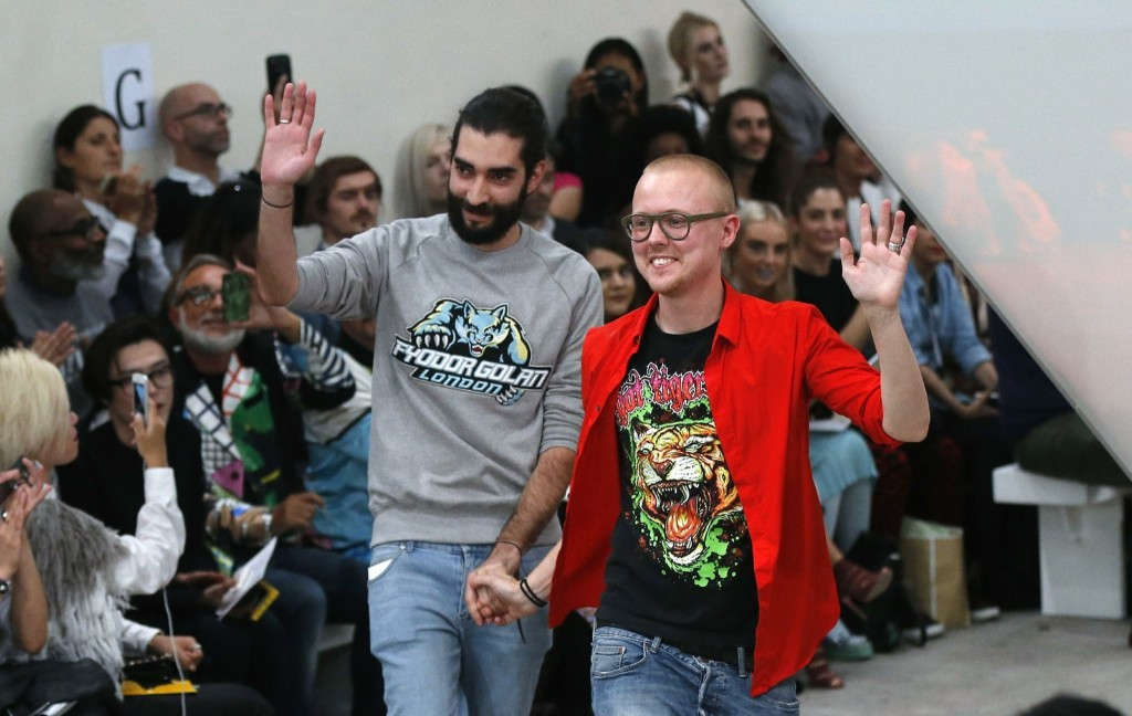Designers Golan Frydman and Fyodor Podgorny acknowledge applause after the presentation of their collection. REUTERS/Suzanne Plunkett