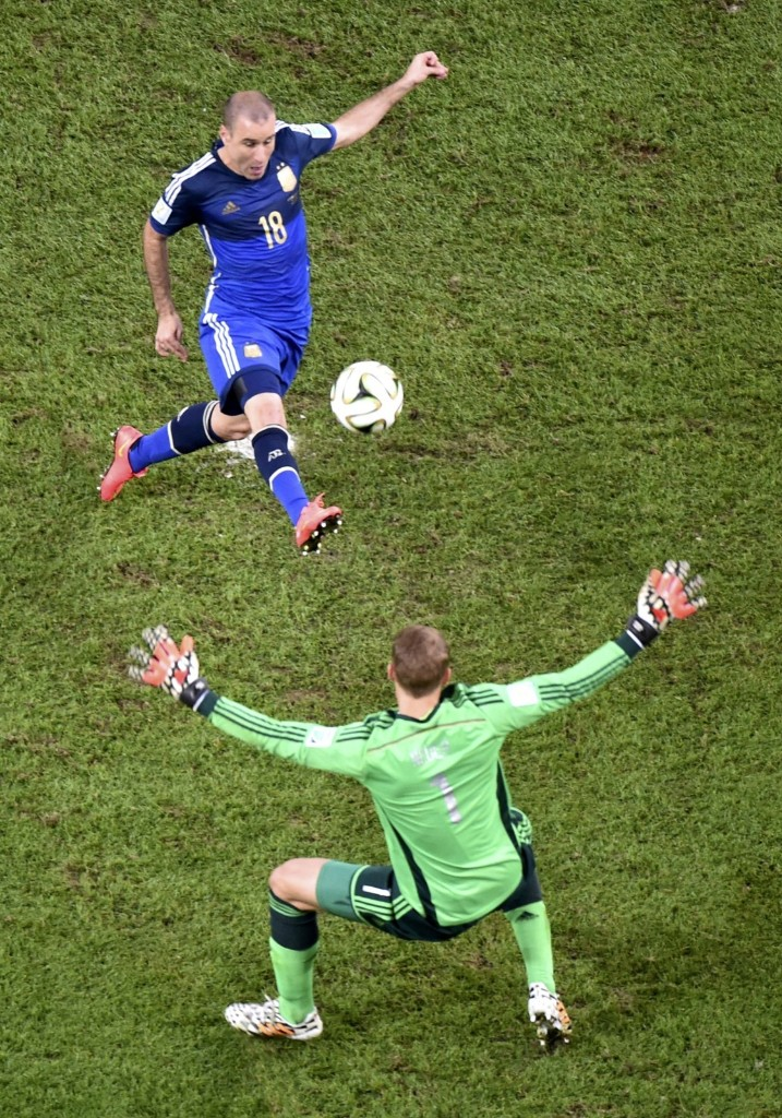 Germany's goalkeeper Manuel Neuer holds out his arms to block shot by Argentina's Rodrigo Palacio late in game. REUTERS/Francois Xavier Marit