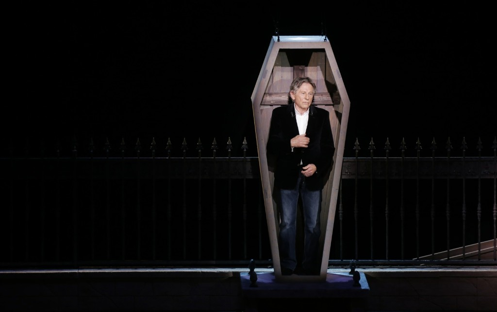 "Roman Polanski stands in a coffin during the musical ""Le Bal des Vampires"" at the Mogador theatre in Paris. REUTERS/Jacky Naegelen"