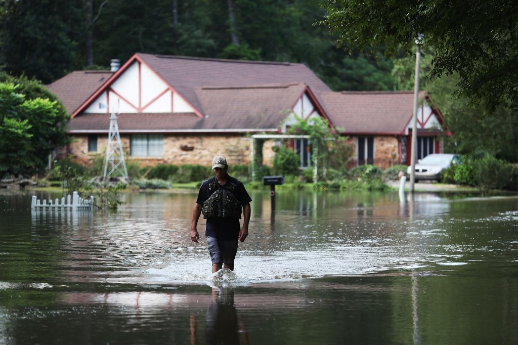 Ryan Evans walks along a flooded road in Baton Rouge. Joe Raedle/Getty Images