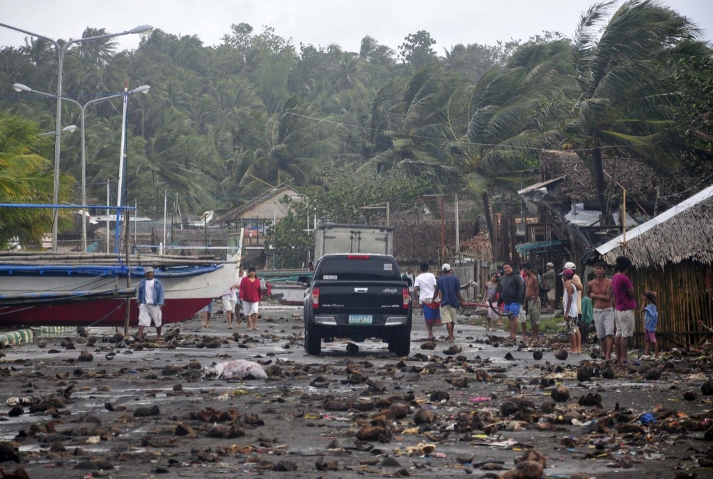 Debris litters the road by the coastal village in Legazpi city following a storm surge brought about by powerful Typhoon Haiyan in Albay province. AP Photo/Nelson Salting