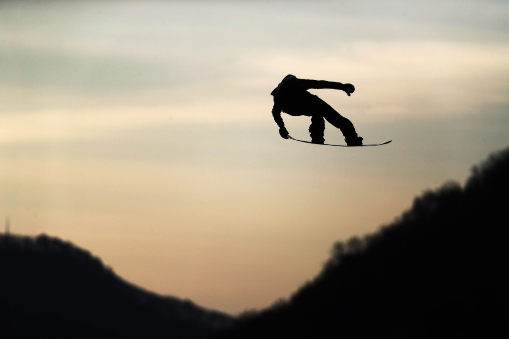 A competitor practices prior to the men's big air qualification. Lars Baron/Getty Images