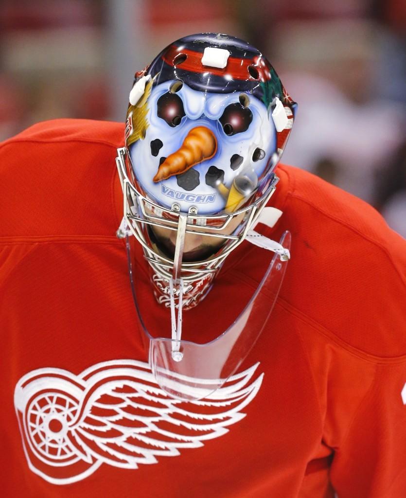 Detroit Red Wings goalie Petr Mrazek wears a snow man painted on his helmet. AP Photo/Paul Sancya