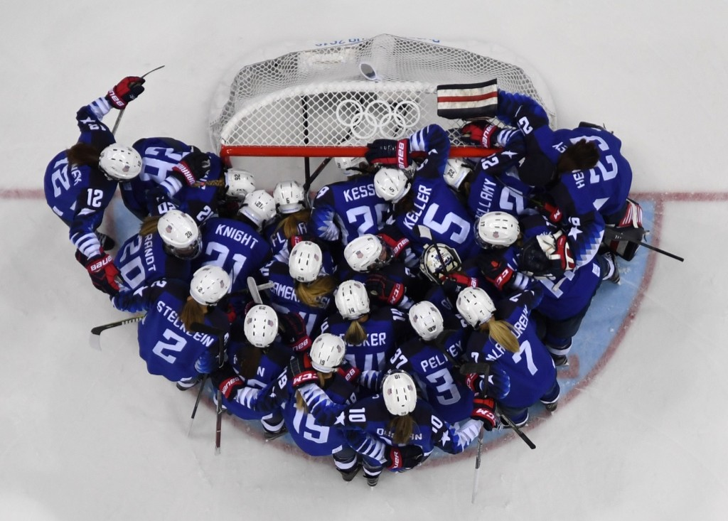 The US team gathers around the net before the start of the women's gold medal ice hockey match against Canada. BRENDAN SMIALOWSKI/AFP/Getty Images