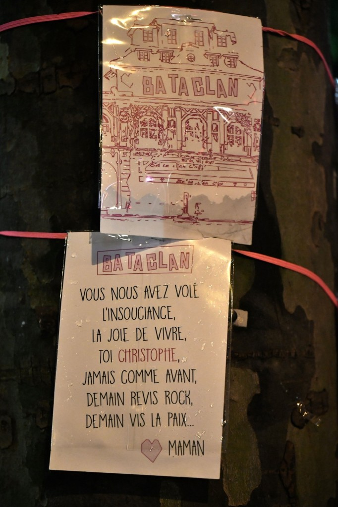 """A placard reading """"Bataclan. You have stolen the carefreeness, the joy of living, you Christophe, never like before, tomorrow re-live rock, tomorrow live peace. Mummy"""" is hung around a tree near the Bataclan concert hall in Paris prior to the reopening concert by Sting. PHILIPPE LOPEZ/AFP/Getty Images"""