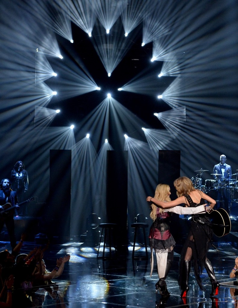 Singers Madonna and Taylor Swift leave the stage after performing 'Ghost Town' during the 2015 iHeartRadio Music Awards, Sunday, in Los Angeles. Kevin Winter/Getty Images for iHeartMedia