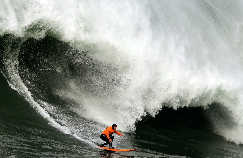 Tyler Fox rides a wave during round one. Ezra Shaw/Getty Images