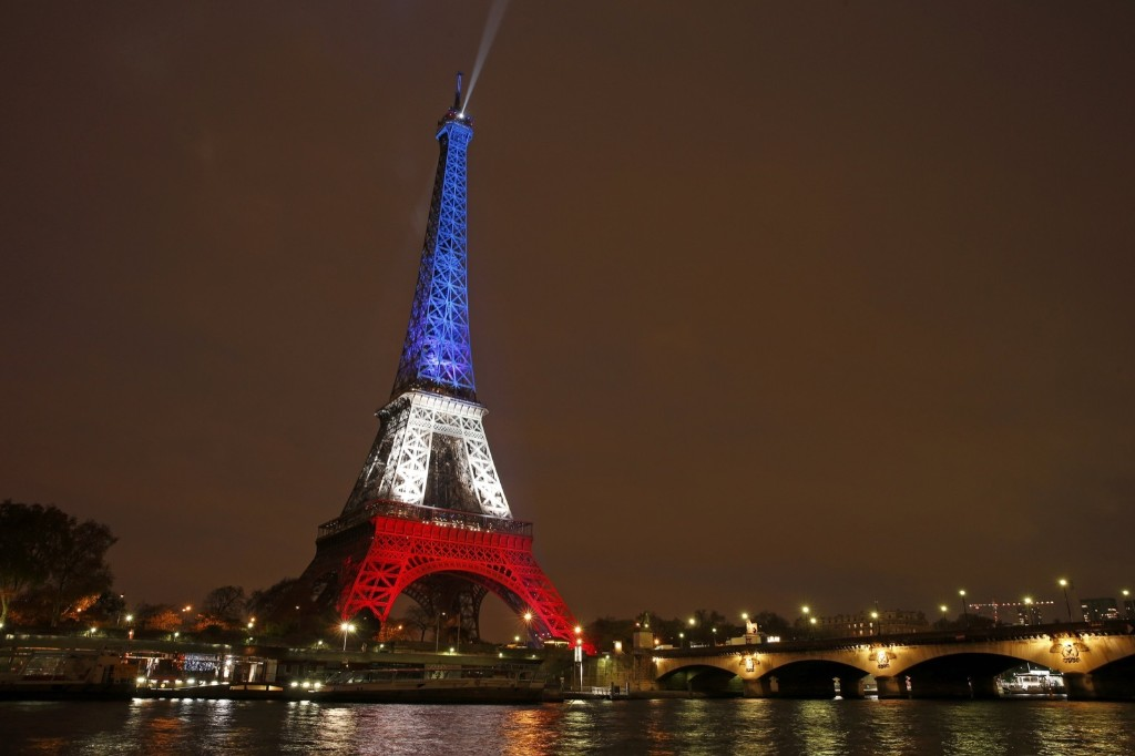 The Eiffel Tower is lit with the blue, white and red colours of the French flag in Paris, France, Monday. REUTERS/Benoit Tessier