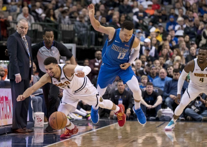 Feb 22, 2019; Dallas, TX, USA; Denver Nuggets guard Jamal Murray (27) and Dallas Mavericks guard Jalen Brunson (13) fight for the ball during second half at the American Airlines Center. Mandatory Credit: Jerome Miron-USA TODAY Sports