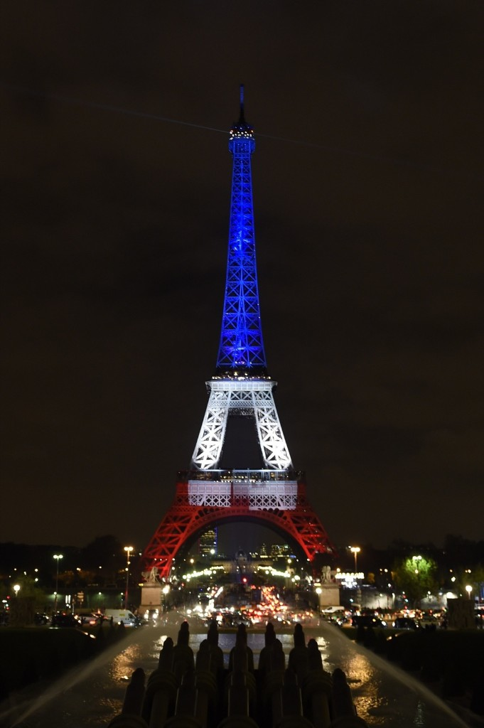The Eiffel Tower, illuminated with the colors of the French flag in tribute to the victims of the November 13, 2015, in Paris, Monday. ALAIN JOCARD/AFP/Getty Images