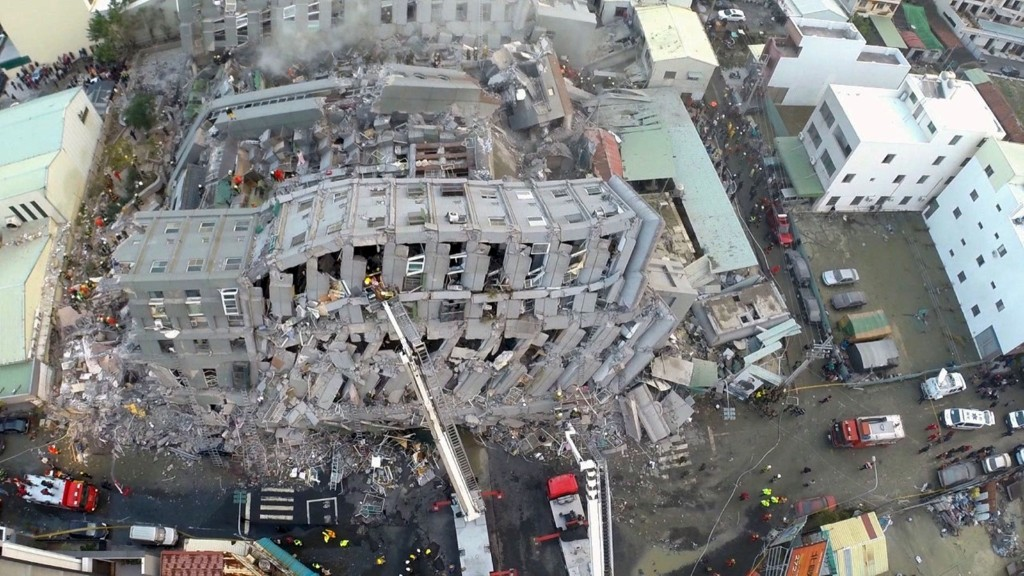 Site where buildings collapsed after a powerful earthquake hit Tainan, southern Taiwan, Saturday, killing several and injuring hundreds. REUTERS/Xinhua