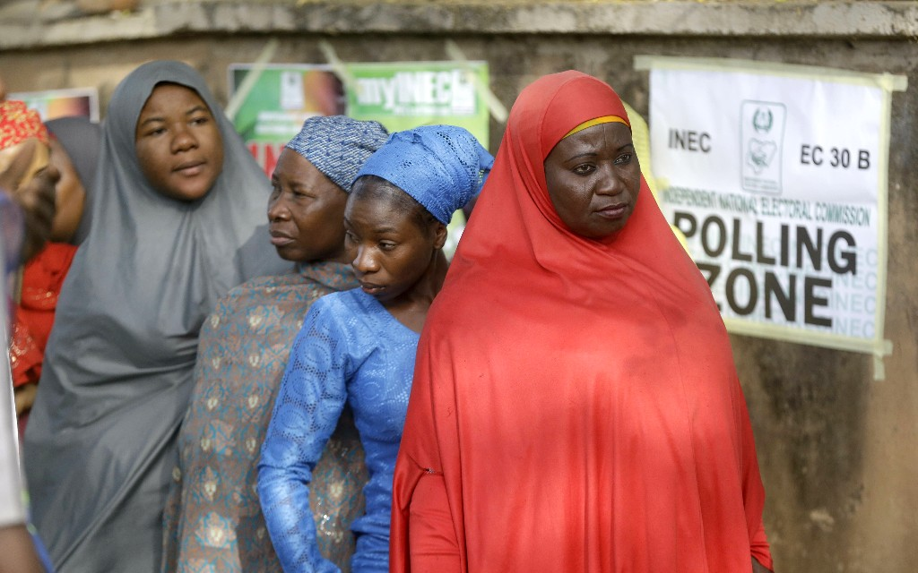 Voters line up to cast their votes during the Presidential and National Assembly election in Yola, Nigeria, Saturday, Feb. 23, 2019. Africa's most populous country goes to the polls on Saturday to decide whether President Muhammadu Buhari deserves a second term. While more than 70 people are running to lead Nigeria, the close race comes down to Buhari and a billionaire former vice president, Atiku Abubakar. (AP Photo/Sunday Alamba)