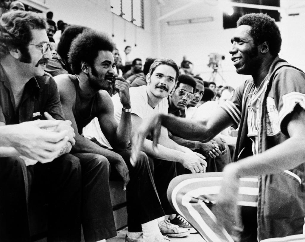 Meadowlark Lemon talking with Attica Prison inmates, July 2, 1975. The Globetrotters played an exhibition game with the New York Nationals in front of 750 prisoners at Attica. AP Photo