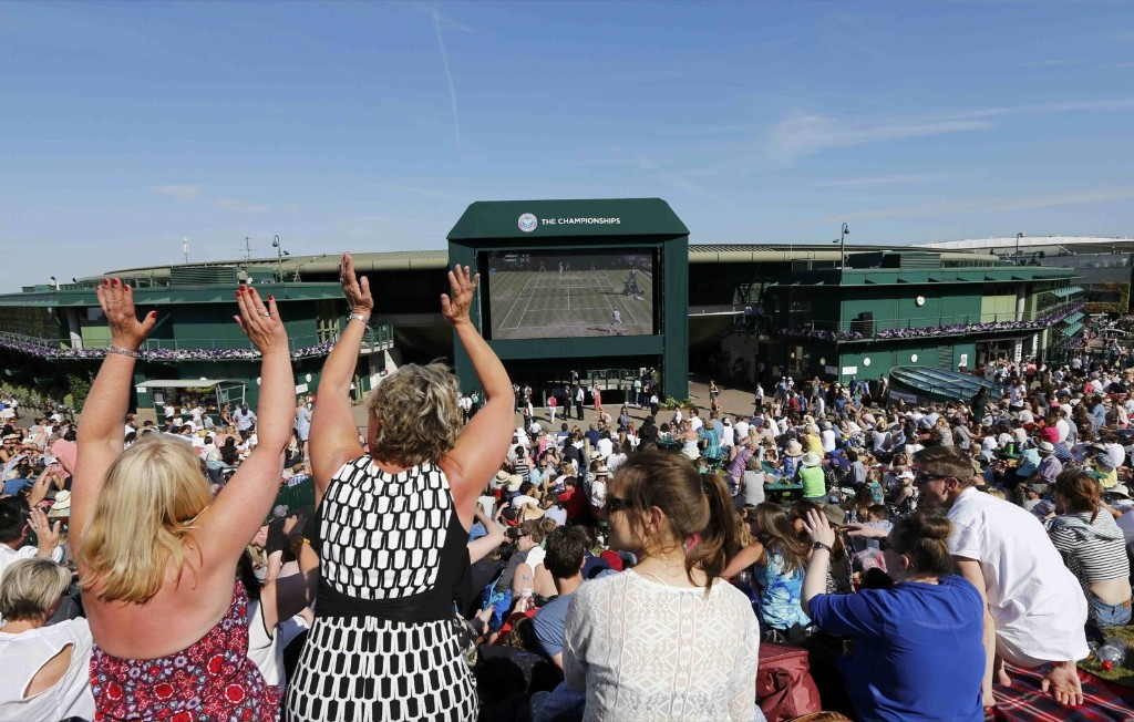 Fans watch Andy Murray on 'Murray Mound' at Wimbledon. REUTERS/Suzanne Plunkett