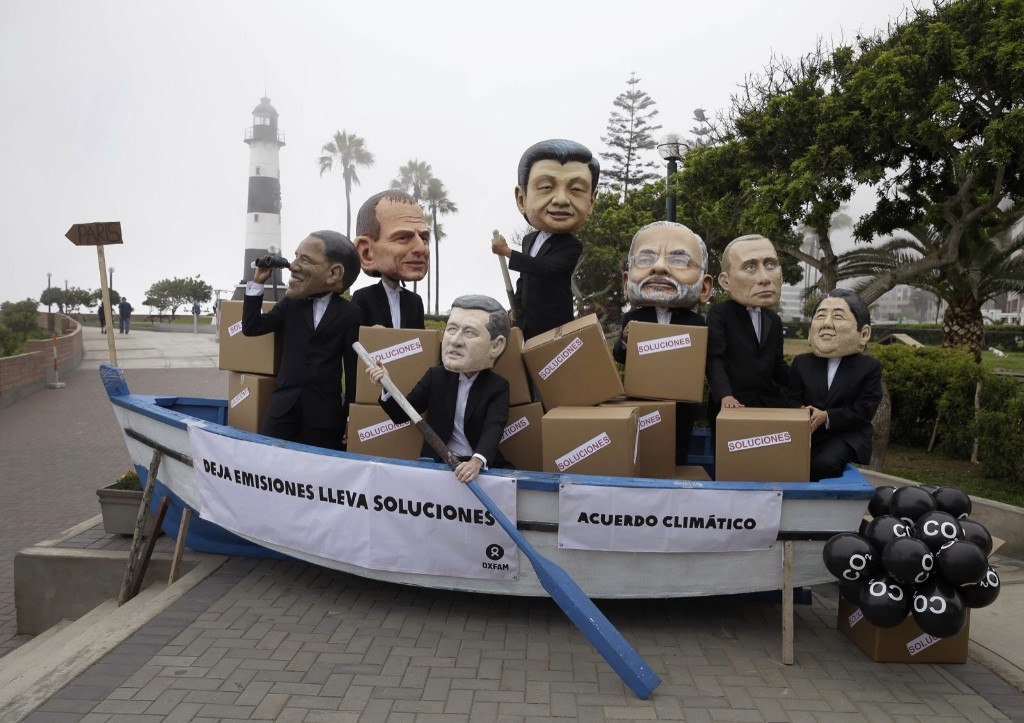 Activists perform as heads of state, from left: President Obama, Australia's Prime Minister Tony Abbott, Canada's Prime Minister Stephen Harper, China's President Xi Jinping, India's Narendra Modi, Russia's President Vladimir Putin and Japan's Prime Minister Shinzo Abe during Climate Change Conference in Lima, Peru. AP Photo/Martin Mejia