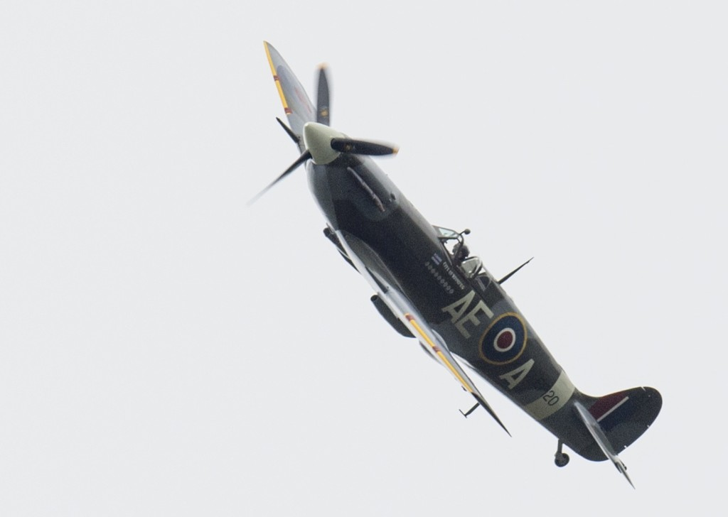 """Spitfire and Hurricane planes take part in a Battle of Britain flypast Tuesday, in Biggin Hill, England. A total of 18 Spitfires and six Hurricanes flew over South East England to mark 75 years since the Battle of Britain's """"Hardest Day"""". On 18 August 1940, both sides, RAF and German Air Force, suffered their greatest losses during the entire battle. Mark Cuthbert/UK Press/Getty Images"""