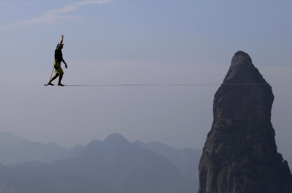 Damian Jorren of Germany walks on a slackline during a show in Taizhou. REUTERS/Stringer