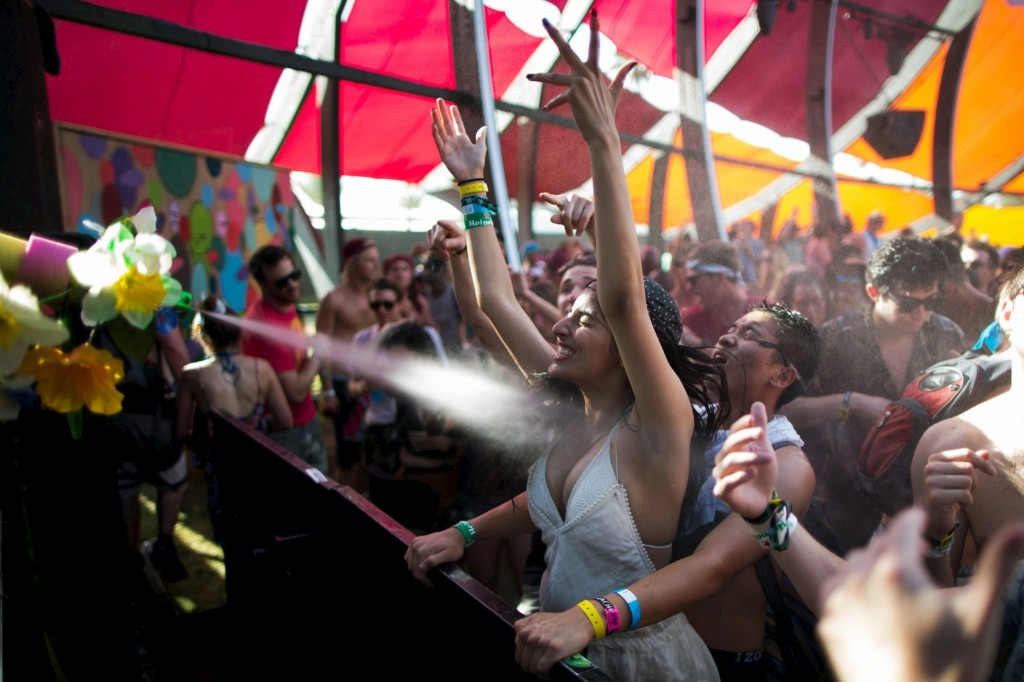 People are sprayed with water as they dance at Coachella. REUTERS/Lucy Nicholson