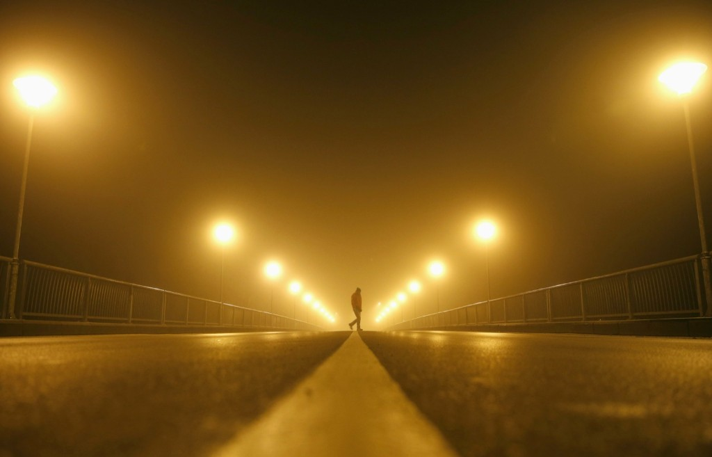 A man walks on the street during heavy smog in the Bosnian town of Zenica. REUTERS/Dado Ruvic