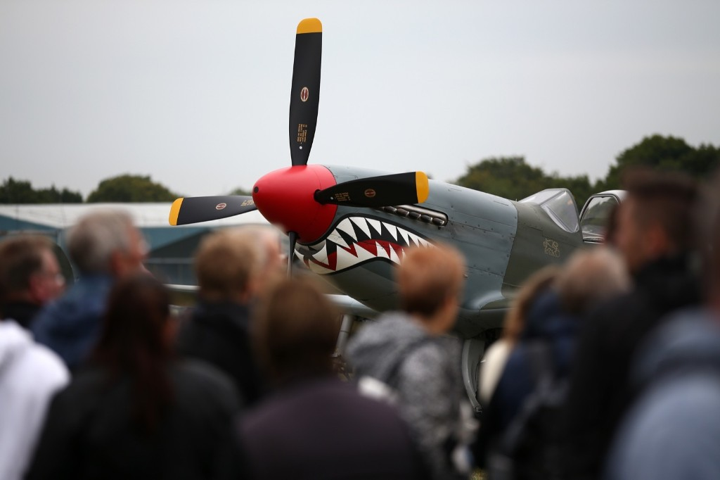 """Visitors view a Mustang fighter jet, Tuesday, in Biggin Hill, England. Aircraft including 18 Spitfires and six Hurricanes flew over southern England to mark 75 years since the Battle of Britain's """"Hardest Day"""" when Biggin Hill and other South East military bases came under attack from the German Luftwaffe. Carl Court/Getty Images"""