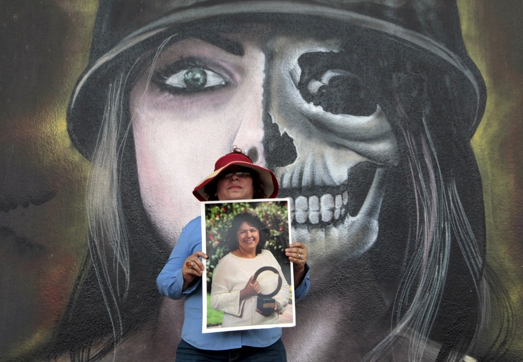 An activist with a photo of slain environmental rights leader Berta Caceres during a march on International Women's Day in Managua, Nicaragua. REUTERS/Oswaldo Rivas