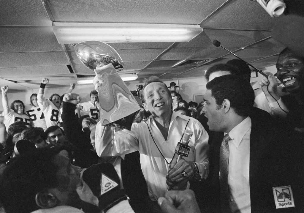 Raiders owner Al Davis holds up Vince Lombardi Trophy in a jubilant Raiders locker room after they defeated the Eagles, 27-10, in Super Bowl XV, Jan. 1981. AP Photo/Paul Sakuma