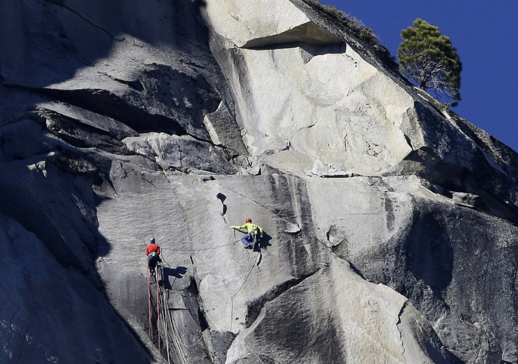 Kevin Jorgeson, left, and Tommy Caldwell climb El Capitan, Wednesday, as seen from the valley floor in Yosemite National Park. AP Photo/Ben Margot