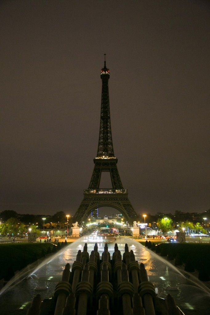 The Eiffel Tower turns off its lights in memory of the more than 120 victims the day after the terrorist attack, Saturday, in Paris, France. Marc Piasecki/Getty Images
