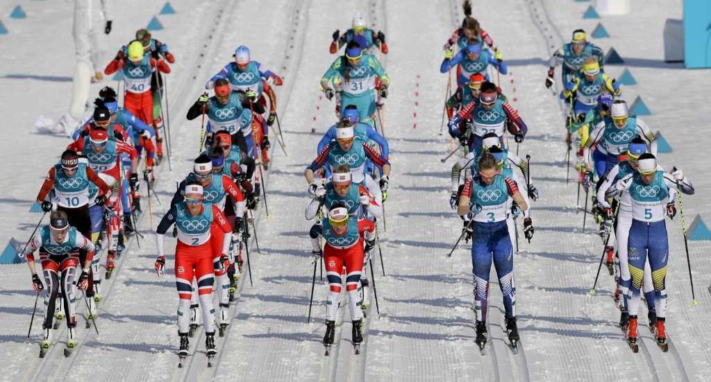 Racers take off at the start of the women's 30k cross-country skiing competition. AP Photo/Kirsty Wigglesworth