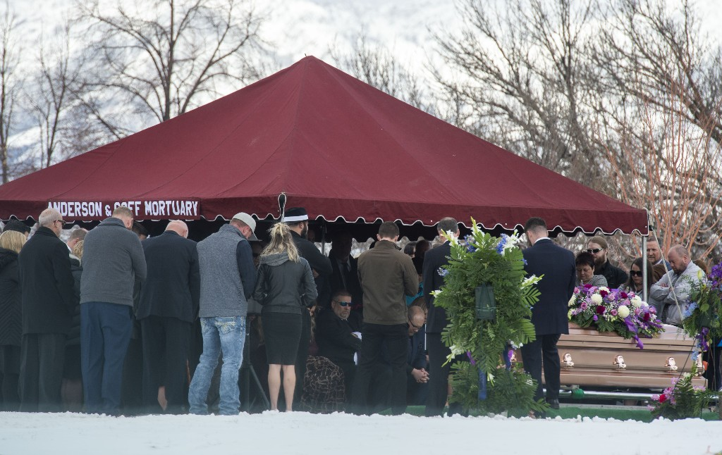 Friends and loved ones gather for the graveside service for Laurie Holt at the Crescent Cemetery in Sandy, Utah, Saturday, Feb. 16, 2019. The family and friends of the Utah woman who spent nearly two years pushing to get her son freed from a Venezuelan jail was remembered for her fearlessness and determination at her funeral. Holt, 50, died unexpectedly Feb. 10 at her Riverton home, less than one year after her son Josh Holt returned to the U.S. after being imprisoned for nearly two years. (Rick Egan/The Salt Lake Tribune via AP)