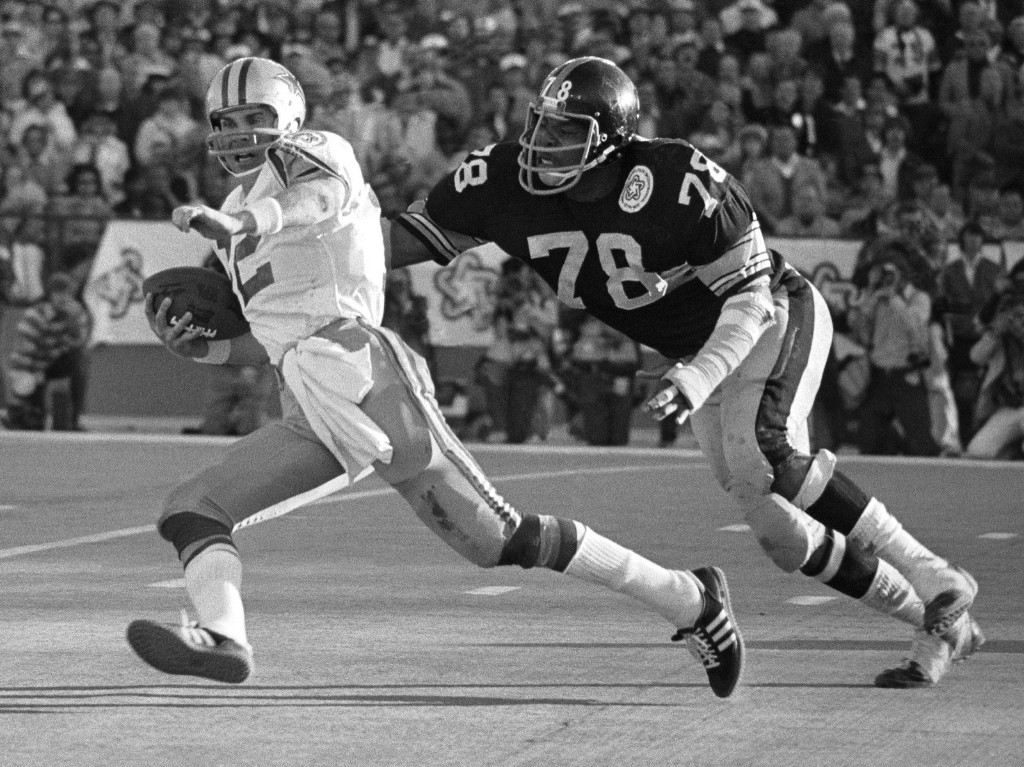 "Dwight White of Pittsburgh's vaunted ""Steel Curtain"" defense chases down Cowboy quarterback Roger Staubach during Super Bowl X, Jan. 1976. The Steelers came from behind to win, 21-17. AP Photo"
