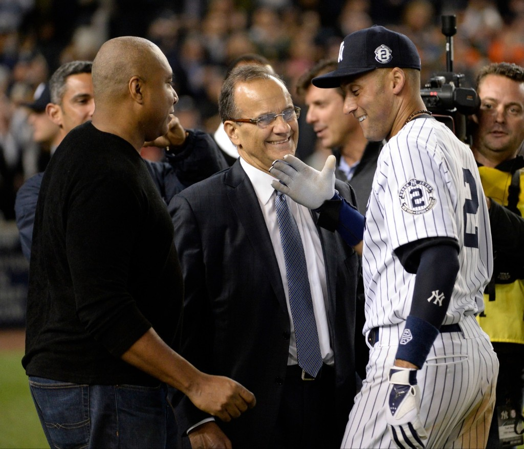 Derek Jeter is greeted by Bernie Williams and Joe Torre after defeating the Orioles. Robert Deutsch-USA TODAY Sports
