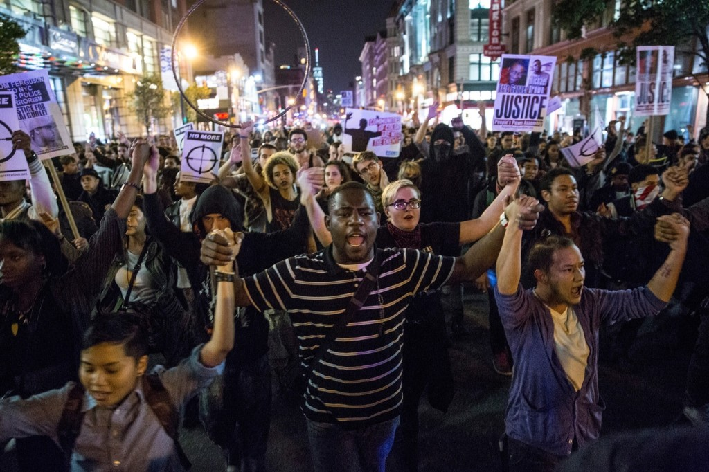 Protesters march through the streets of New York after learning that police officer Darren Wilson would not be indicted by a grand jury. Andrew Burton/Getty Images