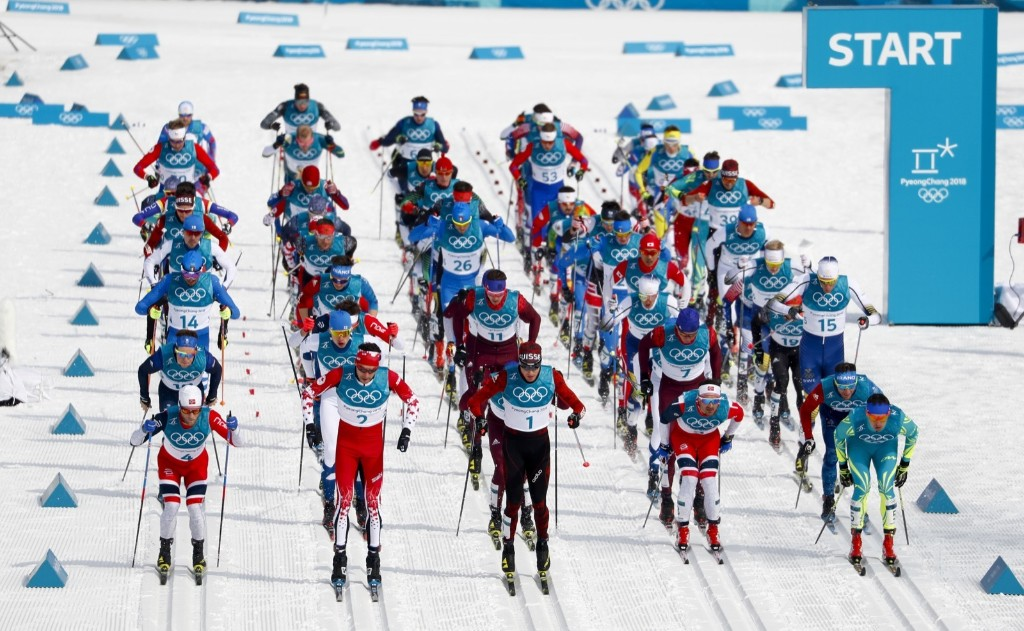 The start of the men's 50k cross country skiing race. AP Photo/Matthias Schrader