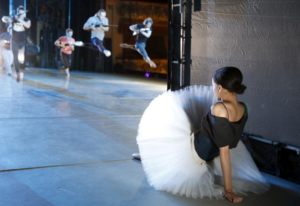 """A ballet dancer watches from backstage during a rehearsal of """"The Nutcracker"""" choreographed by Nacho Duato at the Mikhailovsky Theatre in St. Petersburg, Russia November 20. REUTERS/Grigory Dukor"""