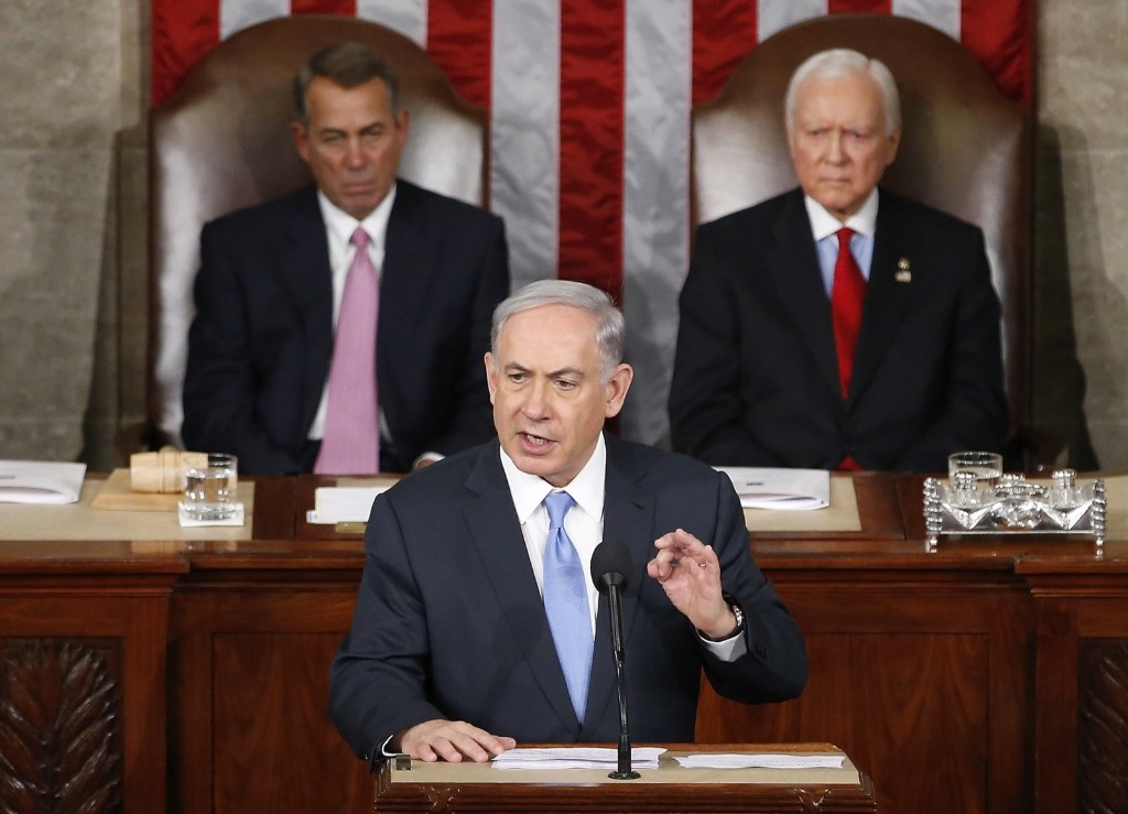 Israel's Prime Minister Benjamin Netanyahu addresses a joint meeting of the U.S. Congress in front of House Speaker John Boehner and Sen. Orrin Hatch at the U.S. Capitol in Washington, Tuesday. AP Photo/Andrew Harnik