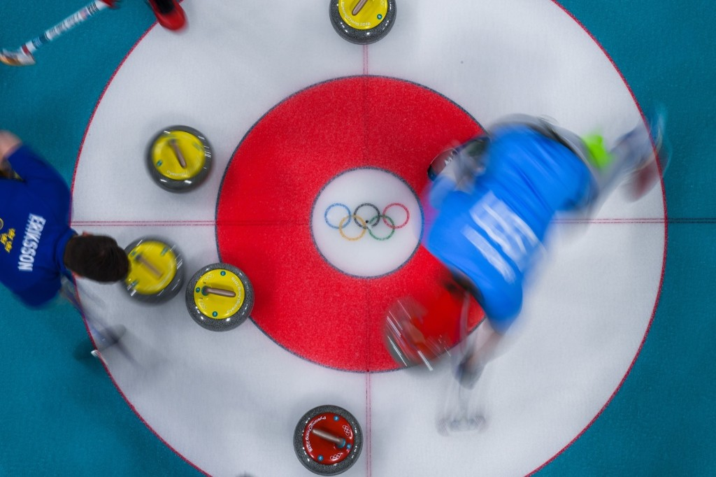 USA's John Shuster brushes in front of the stone during victory in the men's gold medal curling game against Sweden. FRANCOIS-XAVIER MARIT/AFP/Getty Images