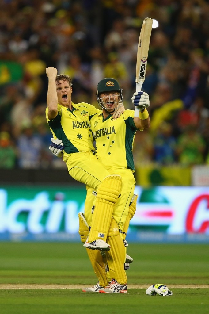 Steve Smith and Shane Watson of Australia celebrate victory during the 2015 ICC Cricket World Cup final match against New Zealand, Sunday, in Melbourne. Ryan Pierse/Getty Images