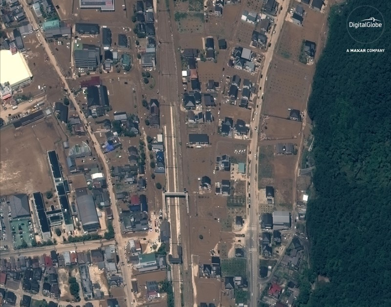 "A satellite image of an overview north of Yasuura Rail Station ""after the floods"" in Yasuura, Japan, captured July 10, 2018. Satellite image ©2018 DigitalGlobe, a Maxar company/Handout via REUTERS"