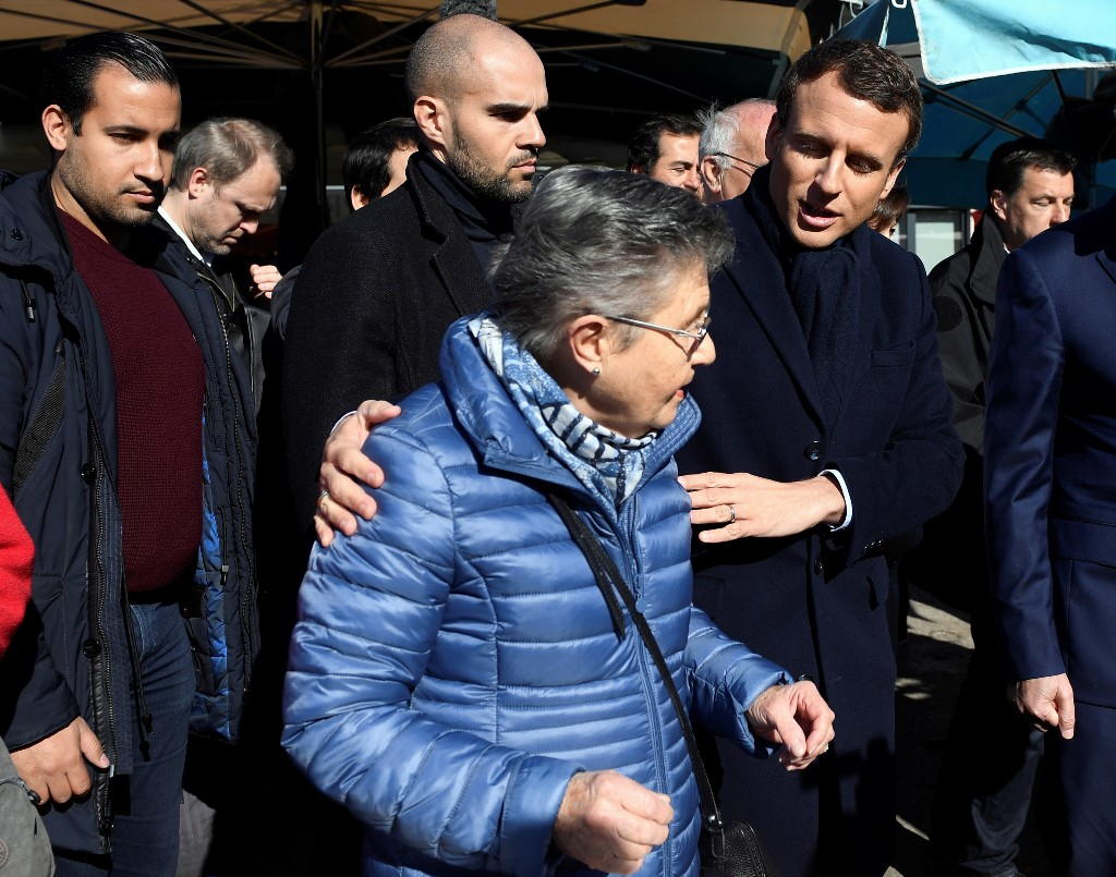 Macron's presidency hurt by ex-aide flaunting gun in photo