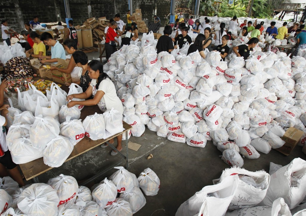 Volunteers pack relief goods inside a Department of Social Welfare and Development warehouse before shipping out to devastated provinces hit by Typhoon Haiyan in Manila. REUTERS/Romeo Ranoco