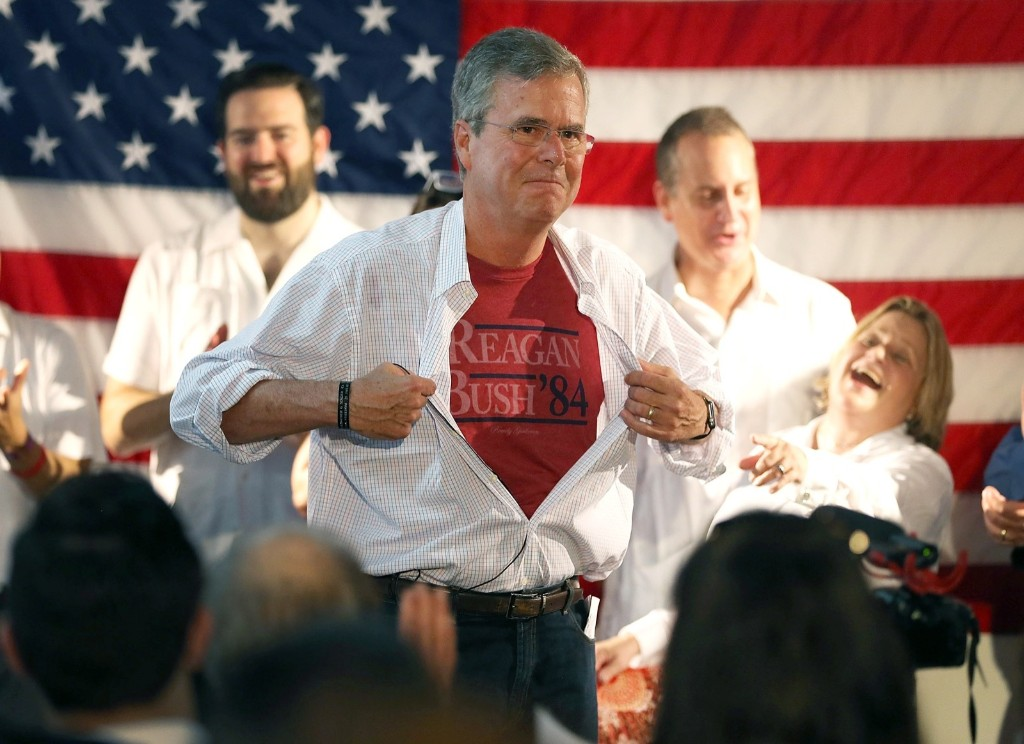 Republican presidential candidate Jeb Bush shows off a Reagan/Bush '84 tee-shirt during opening of a Miami field office. Joe Raedle/Getty Images