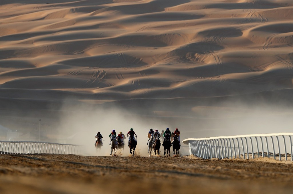 Horses and jockeys during the Liwa Sports Festival at Moreeb Dune in Abu Dhabi. Francois Nel/Getty Images