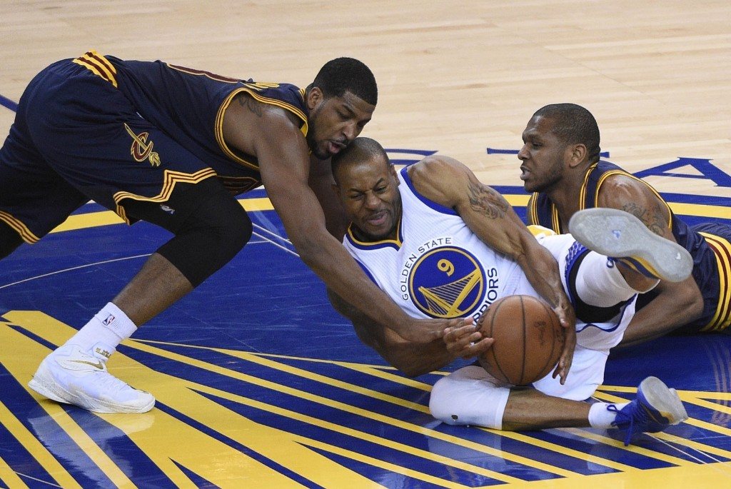 Warriors Andre Iguodala keeps the ball away from Cavaliers Tristan Thompson. Kyle Terada-USA TODAY Sports