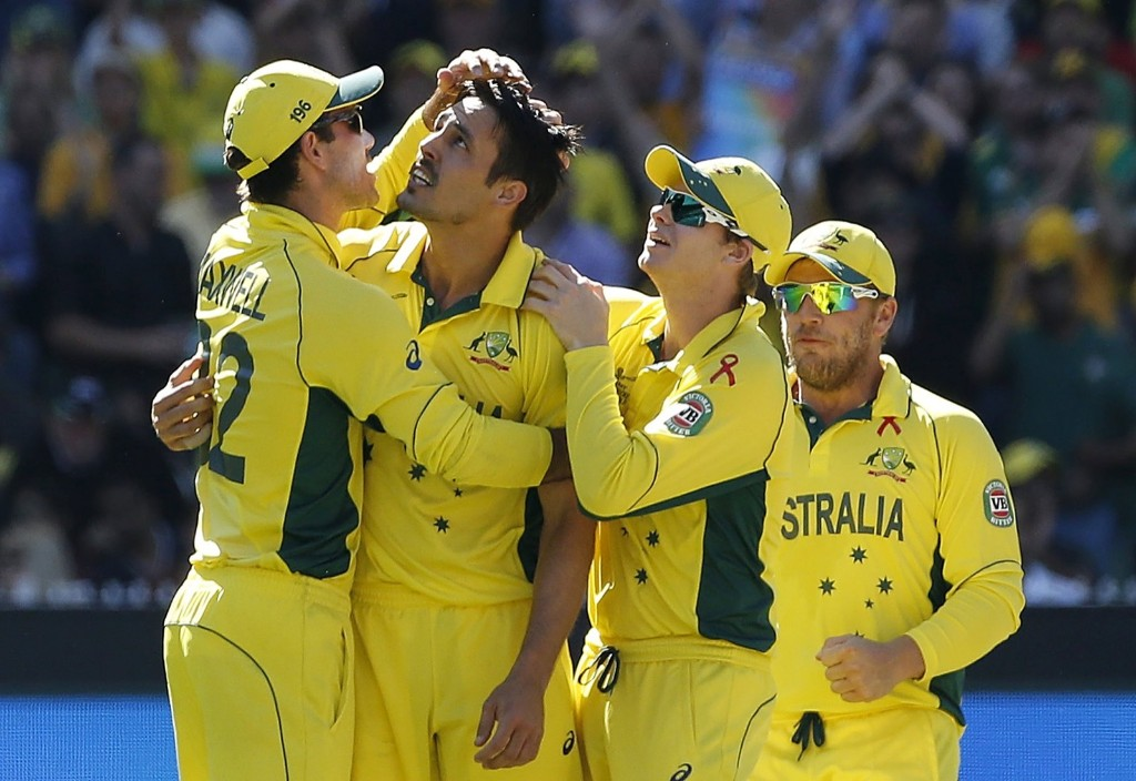 Australia's Mitchell Johnson celebrates with team mates after catching out New Zealand's Kane Williamson for twelve runs during their Cricket World Cup final match, in Melbourne, Sunday. REUTERS/Brandon Malone