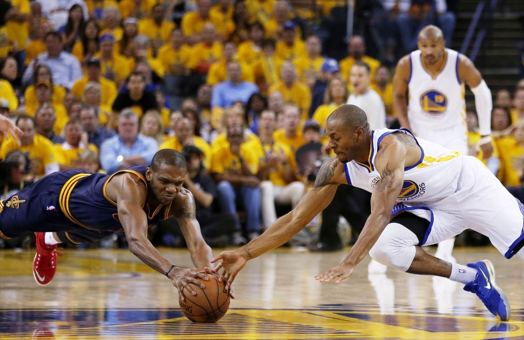 Andre Iguodala of the Warriors and James Jones of the Cavaliers vie for a loose ball. Ezra Shaw/Getty Images