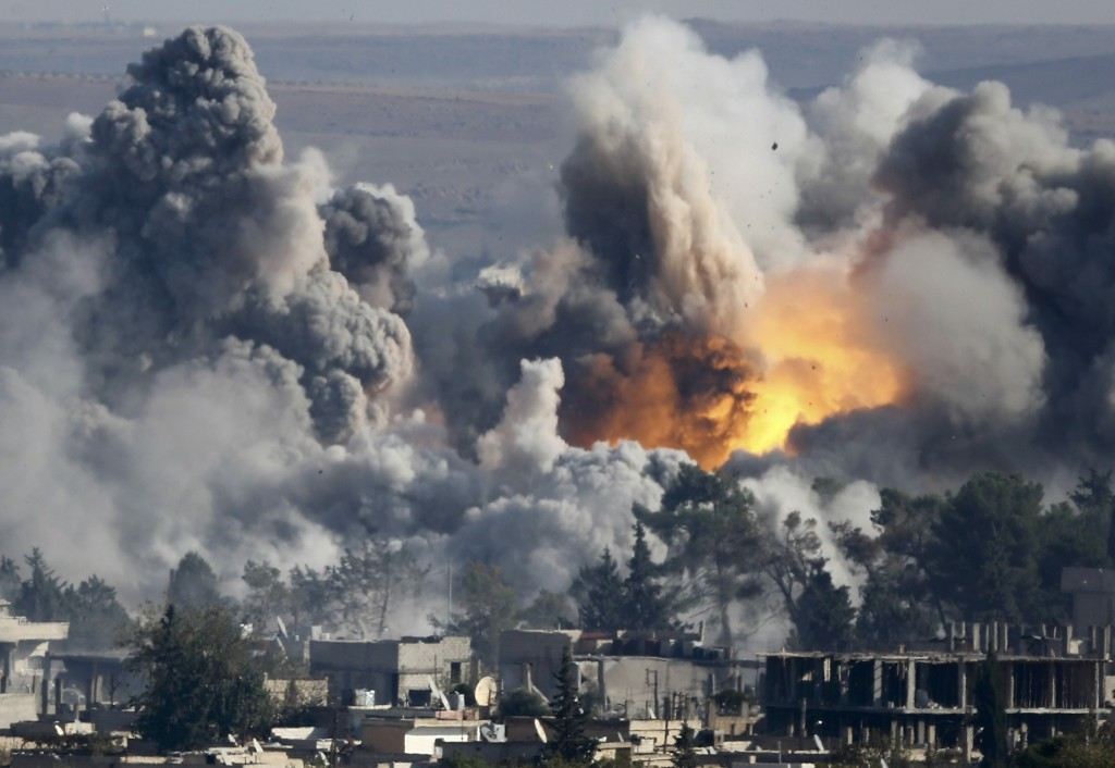 Smoke rises over Kobani after an airstrike. REUTERS/Kai Pfaffenbach