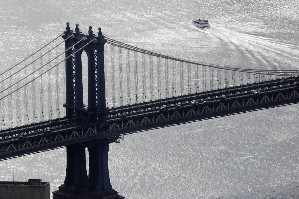 A ferry passes by the Manhattan Bridge in this view from the observatory at One World Trade Center, Wednesday, in New York. AP Photo/Mark Lennihan